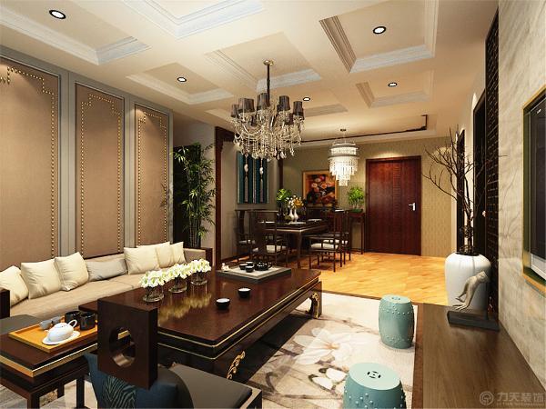 沙发旁的竹子使整个空间更显得儒雅,电视背景墙用的是中间石材通铺,连边用镂空的木框做装饰。使空间更显沉稳。