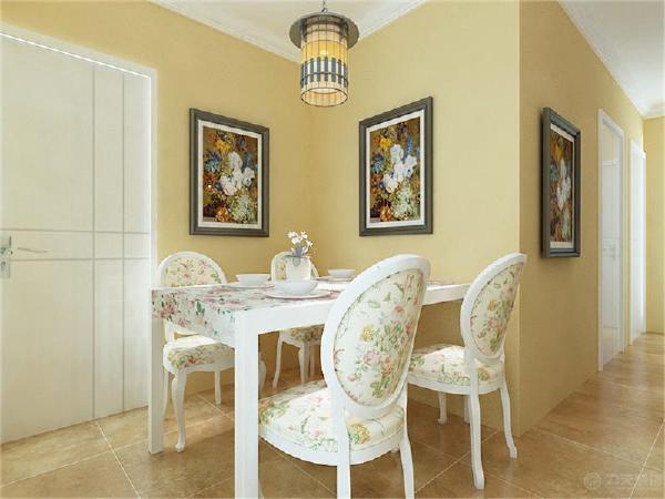 餐厅墙做了个简单的处理,还是与客厅相通刷的浅黄色乳胶漆,其中餐桌椅我也是采用田园感觉的碎花布艺图案的家具,餐桌上摆上一些餐具和花瓶,使餐桌上也并不空寂,可以增加一下就餐的餐厅情调。