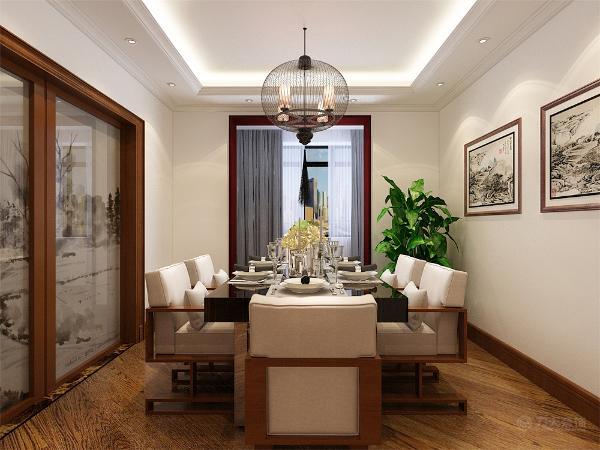 在餐厅的设计中,采用了灰色的座椅,餐桌运用的是不锈钢材质与木质混搭的现代桌椅,就餐区的背景采用的是装饰挂画,边柜和盆栽的配搭使空间更加自然。