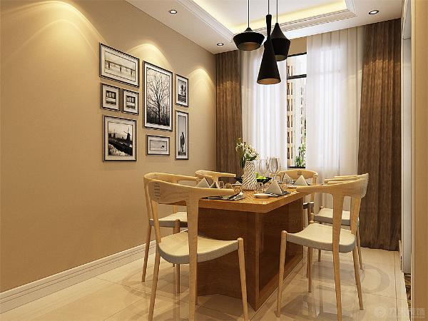 餐厅也是搭配实木餐桌,但座椅比较简约大方,不缺时尚感,也不觉得笨重。墙上挂了一组照片,更显温馨。