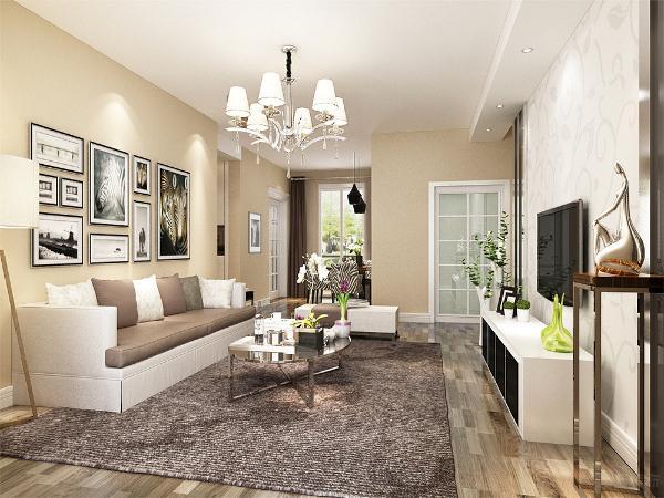 在电视墙的设计上,我们采用了黑镜和不锈钢条的搭配组合,再加上简约素雅的的壁纸,使得简约而又现代感十足在整个装饰装修中客厅永远是比较着重表现的。