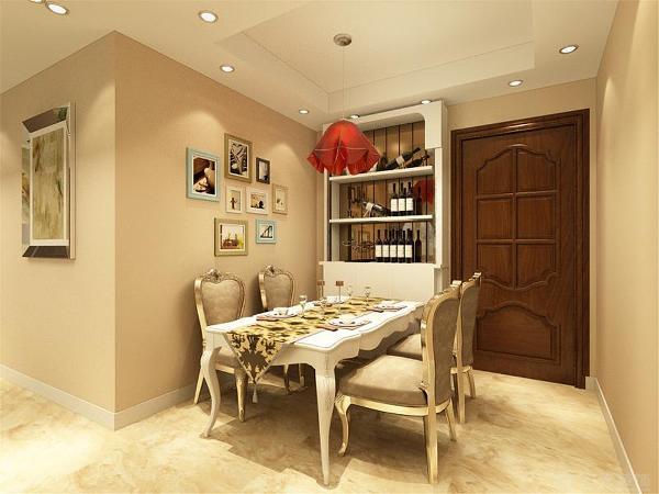 在餐厅区域,放置了一些餐桌等一些必备的家具以及餐具,并且在入户门的一侧摆放了一个酒柜,餐厅背景墙只是做了简单的装饰,整个空间简单而不失细节。与整个空间的设计风格达成一致。