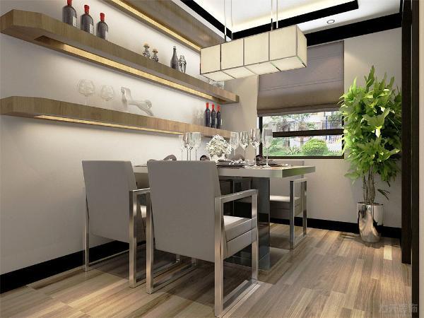 餐厅的左面是次卧室,地面采用强化复合地板,顶面采用回形吊顶,墙面为白色乳胶漆;