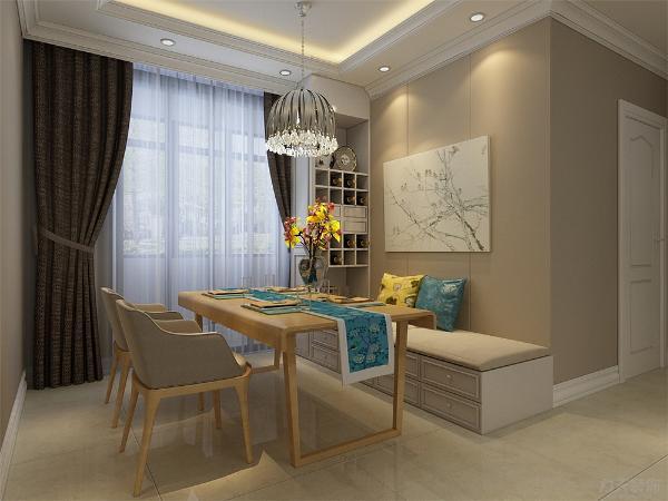 餐厅放置了木色餐桌,且专门设置了榻榻米式的座椅,边上配备了一个小型的酒柜,既节省了空间,又体现了业主别具一格的品位。