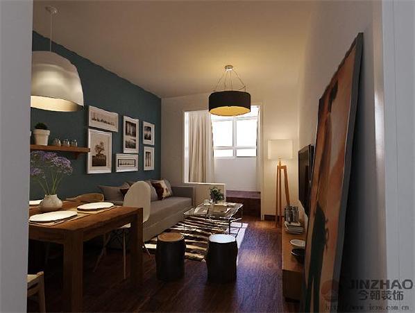此套方案色彩运用大胆,客厅背景墙面采用了蓝灰色调,与其他墙面颜色做了一个突出的深浅对比。阳台做榻榻米地台设计,可用于储物、休闲、休憩等作用。