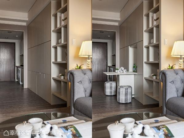 整齐划一的收纳柜立面,可将隐藏式的餐桌完整收拢,机动性设计让走道和餐厅机能完美整并。