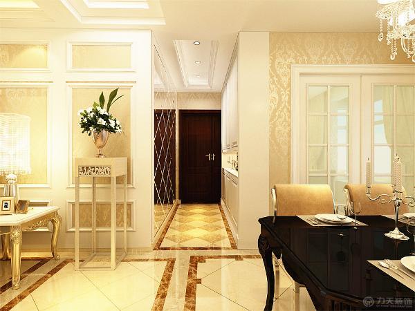 玄关的设计在一开始进入入户门时,玄关是最主要的玄关的两侧一边是柜子,另一边则设计成整面墙体的玻璃镜面,突出一种大气的感觉。