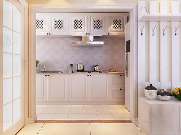 地板使用了木地板作为装饰,厨房同样使用了白色的橱柜。