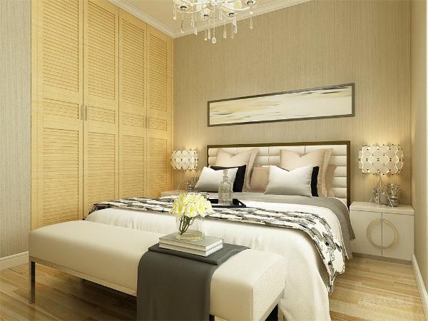 主卧是主人休息的区域,主卧的设计空间合理简洁,白色的床加上黄灰色的靠枕,奠定了温馨的基调,整个墙面贴灰色纹理壁纸,整个空间都充满温馨的氛围。整个空间基调都与客餐厅相呼应。