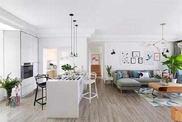 餐厨区和客厅通过小吧台来隔开,让空间看上去足够宽敞,也各自独立。