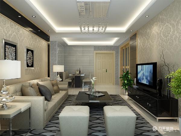 客厅部分的电视背景墙造型相对简洁大气,色调深浅对比,富有层次感。沙发背景墙与电视背景相呼应,同样用黑镜金色壁纸形成色彩上的对比,增强层次感。