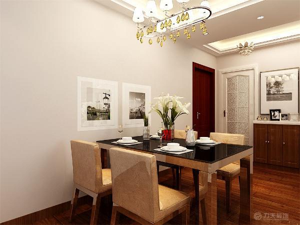 餐桌的背景墙则采用俩幅画作为装饰元素,一盏简洁的吊灯作为主光源的照入。厨房则采用白色的集成吊灯进行装饰,白色的橱柜以及浅色的地砖相互的配合。