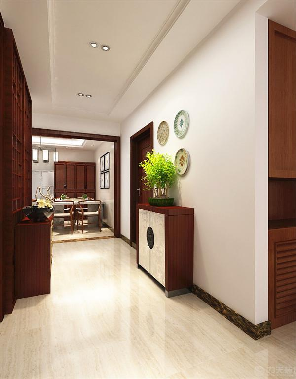 入户门的一侧安置一个入户鞋柜。将厨房向餐厅延伸出一部分,使厨房空间变的宽敞,