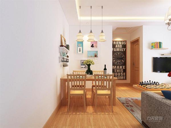 客厅空间为L型沙发另外在客厅内安放了一个四人餐桌,顶面为回形吊灯,沙发背景墙为淡蓝色,整个空间温馨而舒适。