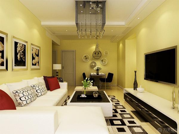 沙发采用浅色L型沙发,用彩色抱枕加点缀,沙发背景墙以画为主,起到点缀修饰作用。