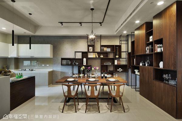 餐厨区壁面特别漆上灰色马来漆,营造内敛朴质氛围,并与灯光融合,呈现动人的光泽变化。