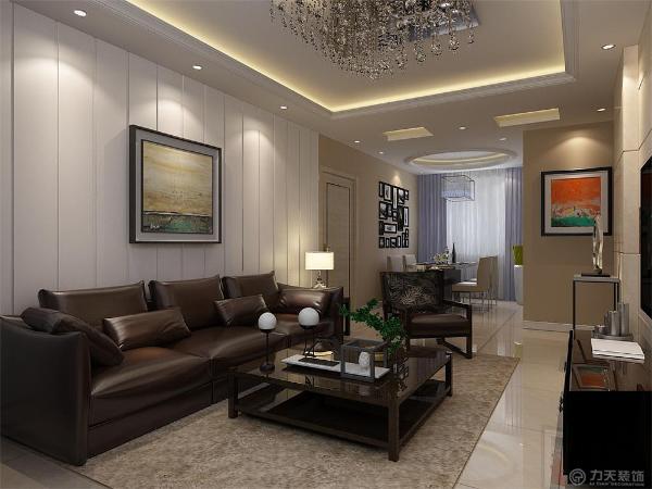 客厅作为家庭生活活动区域之一,客厅是主人品位的象征,体现了主人品格、地位,也是交友娱乐的场合,本案电视背景墙采用大理石,下方放了几组组合装饰,显着非常美观。