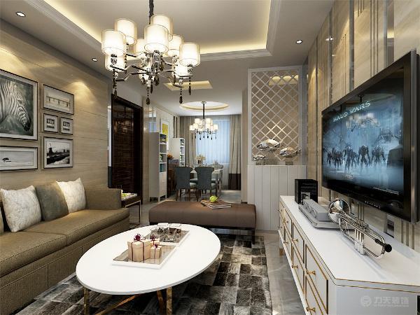 客厅用家具和装饰来营造整体效果,简约的布艺沙发,是现代简约式客厅里的主角