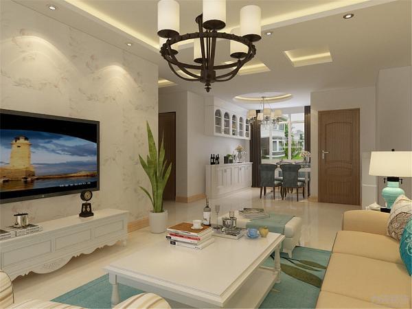映入眼帘的就是客厅,客厅运用回字形吊顶,突出顶面敞亮和大气,首先就会给人以简洁大气的感觉.也能使空间得到最大化的利用率。