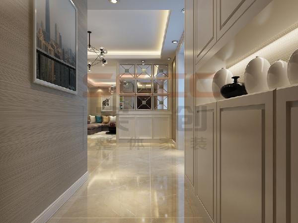 设计师在入户走廊的墙体上进行了改动,拆除了走廊的墙以背靠背的柜子来取代,充分利用利用空间,既增加了收纳功能也同时保证了美观。