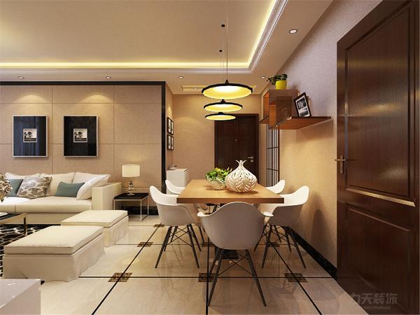 餐厅的区域在入户门与客厅的中间,简单的木质餐桌搭配白色座椅还有三盏别致的吊灯,使整个餐厅显得更加舒适温馨