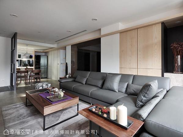 利用大理石墙替空间营造清爽舒适感,亦于墙面两侧设计收纳展示柜,异材质与不规则的柜体设计,丰富空间调性。