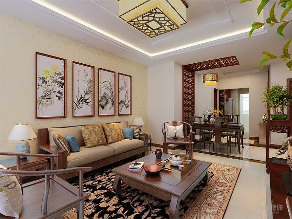 客厅是主人会客的地方,在沙发背景墙选择中式特有的山水画做装饰,电视背景墙也同样选择中式花格来修饰搭配中式的红木家具。整个空间利用合理,适宜居住。