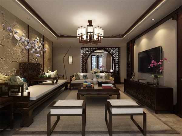 客厅以沉稳的木色调为主,电视背景墙采用大面积的素色壁纸,不仅使人视线得到拓展、放松,更体现了空间设计中的有限的空间里制造纵深感的设计理念。
