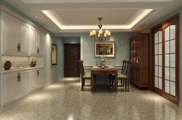 地面铺贴米灰色的地砖,同时配有美式的家具与装饰画,使其文化气息更浓郁。餐边柜的设计方便了主人日常放置一些物品,或是收藏几瓶美酒。整个餐厅的设计为主人提供了舒适的用餐环境。