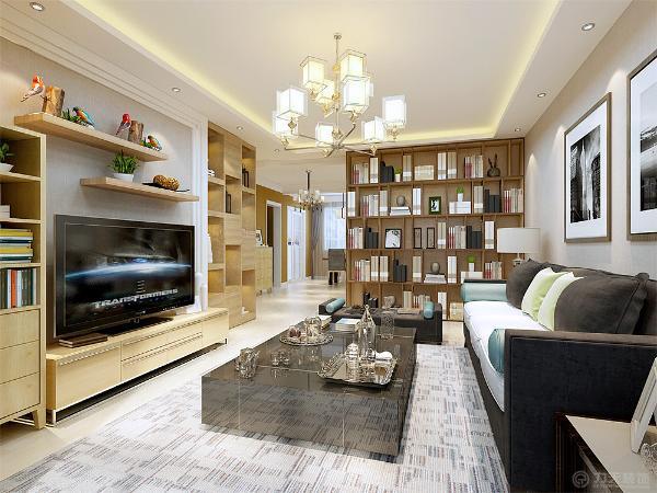 客厅电视墙用石膏线收边加上浅色的壁纸,搭配原木色的家具和小格架,和浅灰色系的组合沙发,及复古的大书甲,尽显整体客厅的现代和复古感。