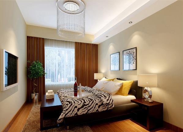 在卧室部分,地面平铺木地板,顶面采用石膏板制作了一个小造型,并加上了灯带以作修饰,卧室中央悬挂了一盏华丽的水晶灯。
