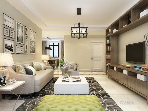 挂画来进行装饰,表现了一种现代气息感,沙发采用的是灰色系列。配搭深灰花纹地毯,窗帘结合家具的颜色为浅灰色,墙面运用的是绿灰色的墙面,电视背景墙为整体书柜的形式,集储物与装饰为一体,多种功能并用。