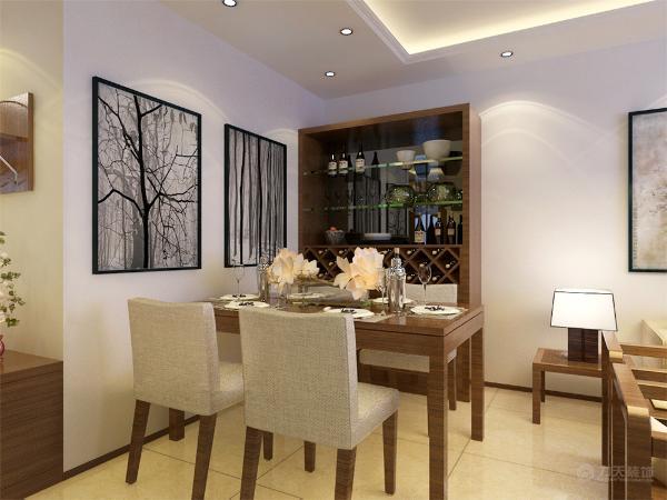 在餐厅的设计中,同样采用了木质餐桌和米色的椅子和客厅相呼应。酒柜和挂画创造出了新中式的格调高雅。