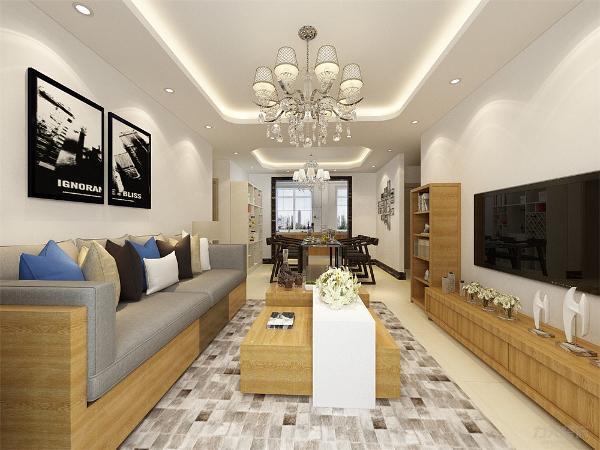 沙发采用了黄色木纹样式,和茶几,电视柜搭配,更有质感,沙发上放了很多抱枕,颜色也很多,使空间更有活力,不单调,沙发背景墙放了两张很有个性的壁画,使空间不平庸,更有感觉,茶几选择也很有特色