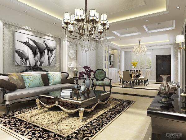 客厅设计采用整体白色调为主.以大理石、淡啡色以及欧式墙纸做主要装饰,白木线及石膏线边框作点缀.笔直简约的线条同样能勾勒出豪华时尚的气息