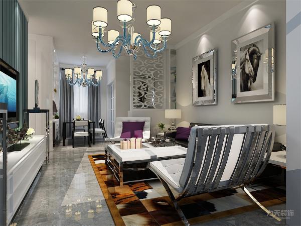 客厅与餐厅是整个在一个空间的格局。通过电视背景墙使用了鲜亮颜色的条纹壁纸作为装饰装饰,使整个家庭色调精彩。沙发墙运用壁纸配合照片墙的表现形式和各种装饰的表现形式,更加彰显业主的品味与内涵。