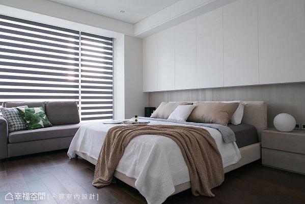 次卧利用悬挂式上柜规划收纳机能,搭配柔和、典雅的暖色设计,提升屋主睡眠质量。
