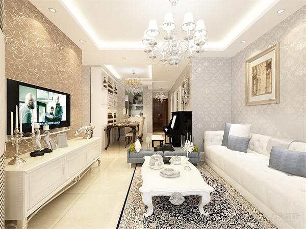 客厅采用了回字形吊顶石膏线圈边,并用水晶的欧式吊灯营造气氛,在这个客厅的整个色调上采用的是暖色系,墙面是欧式的亮面浅蓝色壁纸,家具采用白色欧式沙发,渲染了简欧的清新色彩