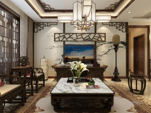 客厅的设计,沙发背景应用了带有色彩的国画的墙纸,加上非常中国风的国画装饰,搭配带有色彩的沙发,格调高雅,造型简朴,色彩浓重而成熟。电视背景墙只是简单的做了一个处理