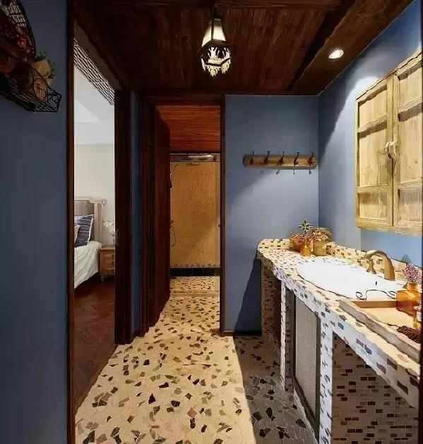 ▲卫生间的地砖选的很特别,像鹅卵石铺成的小路,打造出清新的氛围。