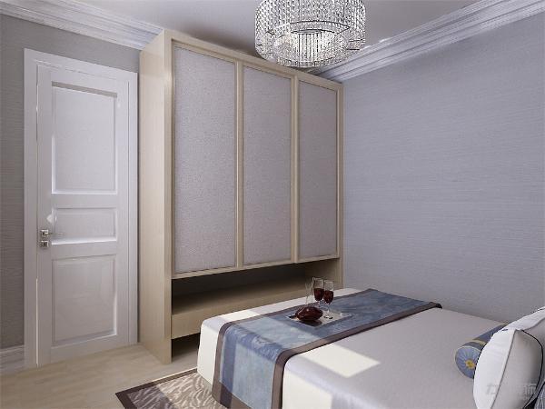 主卧室采用干净低调的冷色调为主,吊顶做了石膏线造型,背景墙选择的浅咖色与室内的衣柜颜色做呼应形成对比。