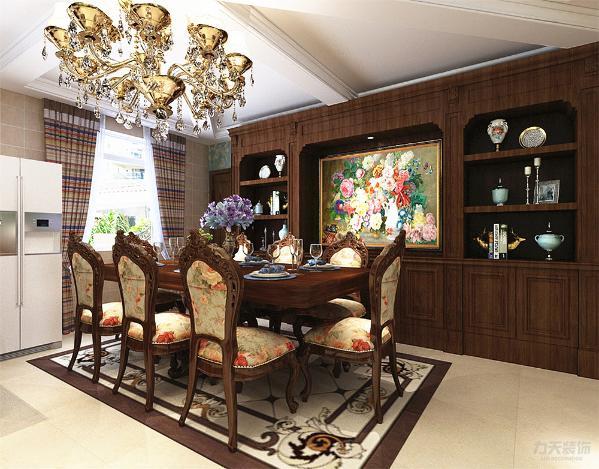 餐厅紧邻客厅并且在餐厅处酒柜的摆设凸显了餐厅的大气并且酒柜中间还有一幅装饰画显得更为优雅