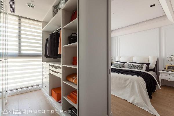 于主卧室隔出更衣空间,柜体采多功能收纳设计,满足屋主实用机能诉求。