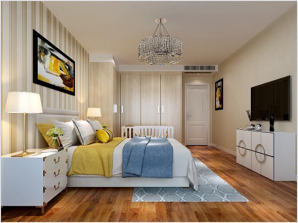 主 卧:卧室是在家里呆的时间较长的一个空间,颜色以暖色调为主,木质地板搭配壁纸,在收纳上也是合理布局做了两组柜子,合理的将电视放入其中,考虑到业主准备宝宝的打算,在衣柜出留有足够的空间放了婴儿床。