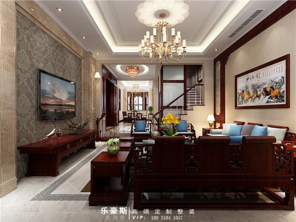 这里是入户客厅的装修效果图。整个空间家具采用的是中式风格的家具,不过在细节处还是混搭着些许的其他元素,塑造出一种折中性的气质,这并不是简单的随意组合,而是建立在一定的文化修养上面的。