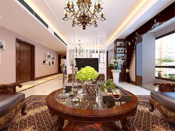 客厅顶地面整体设计,使空间有延伸感,中间镂空隔断营造出隔而不断的艺术效果