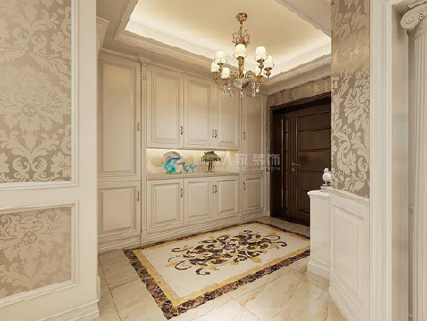 入户门厅这个地拼很是喜欢,看着很大气。玄关柜采用和整体空间颜色一致的米白色柜子,精致的拉手让柜子看上去更加的有质感。