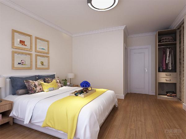 主卧室与次卧室的设计与整体设计相统一,以舒适为主。双人床与床头柜,再搭配上具有储物功能的衣柜,整体空间简洁明亮极具现代感。