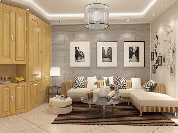 客厅的设计上,以奶咖调为主,家具的选用的是灰棕条纹与白色相间,沙发配搭彩色的抱枕使空间增添了活力,地毯采用的是咖色花纹,做到了与抱枕的呼应,沙发背景墙采用的是挂画装饰增添了空间的生趣