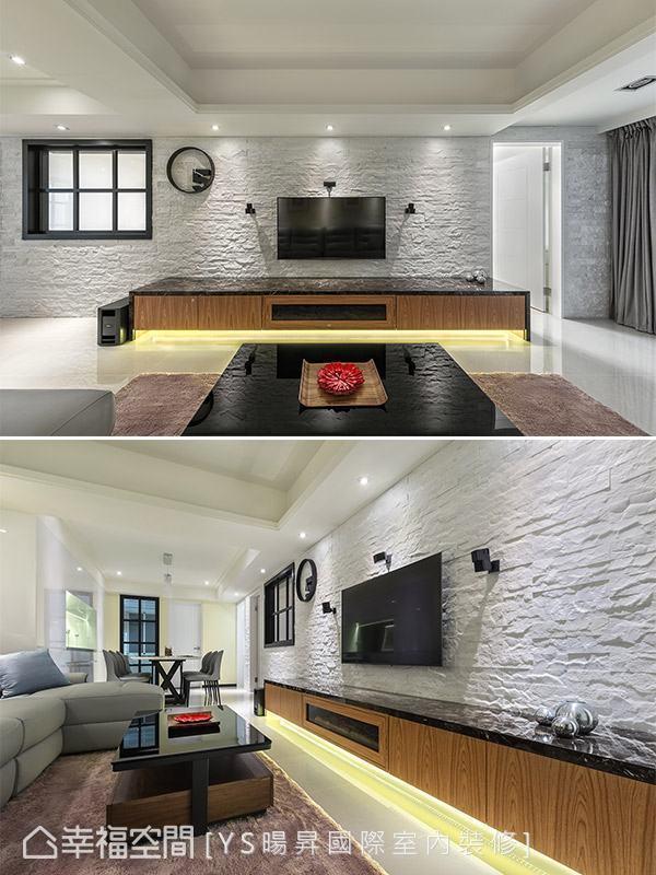 李宗育设计师采用文化石堆砌电视墙面,并持续向空间内部延伸,形成一气呵成的立面视觉效果。